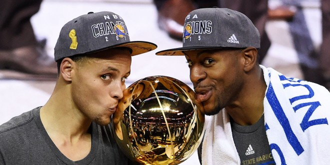 CLEVELAND, OH - JUNE 16: Stephen Curry #30 and Andre Iguodala #9 of the Golden State Warriors celebrate with the Larry O'Brien NBA Championship Trophy after defeating the Cleveland Cavaliers in Game Six of the 2015 NBA Finals at Quicken Loans Arena on June 16, 2015 in Cleveland, Ohio. NOTE TO USER: User expressly acknowledges and agrees that, by downloading and or using this photograph, user is consenting to the terms and conditions of Getty Images License Agreement. (Photo by Jason Miller/Getty Images)